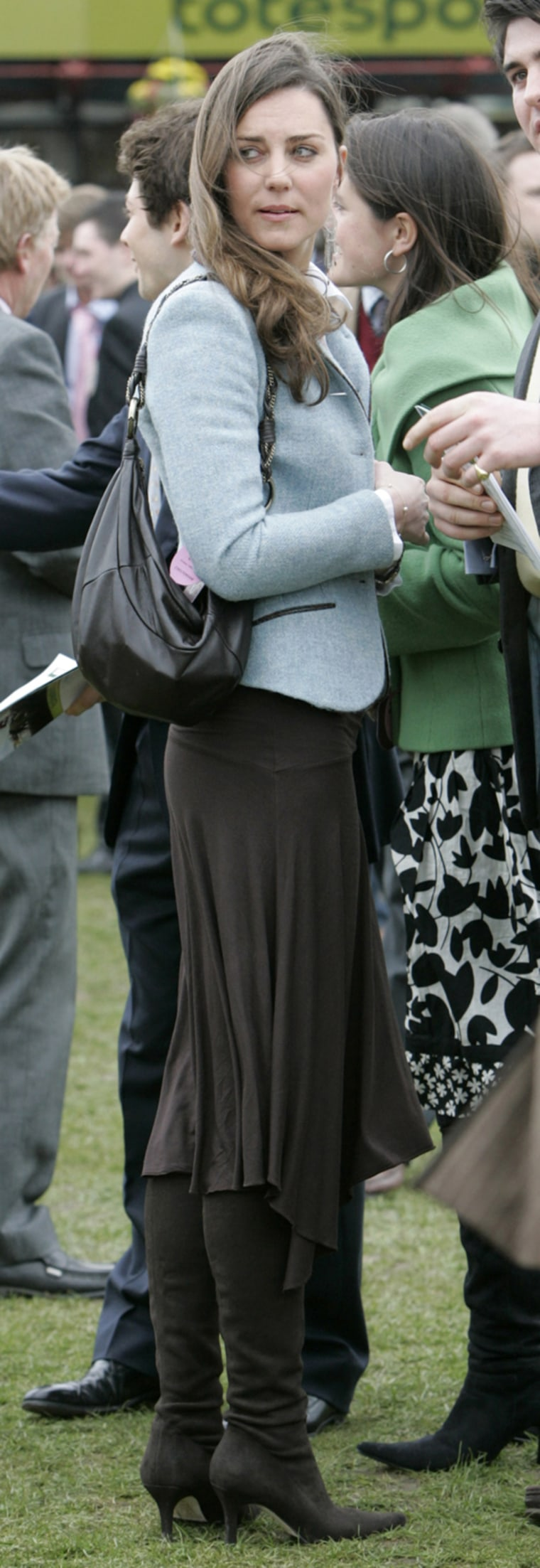 Image: File photograph shows the girlfriend of Britain's Prince William, Kate Middleton, attending the final day of the Cheltenham Festival horse racing in Gloucestershire, western England