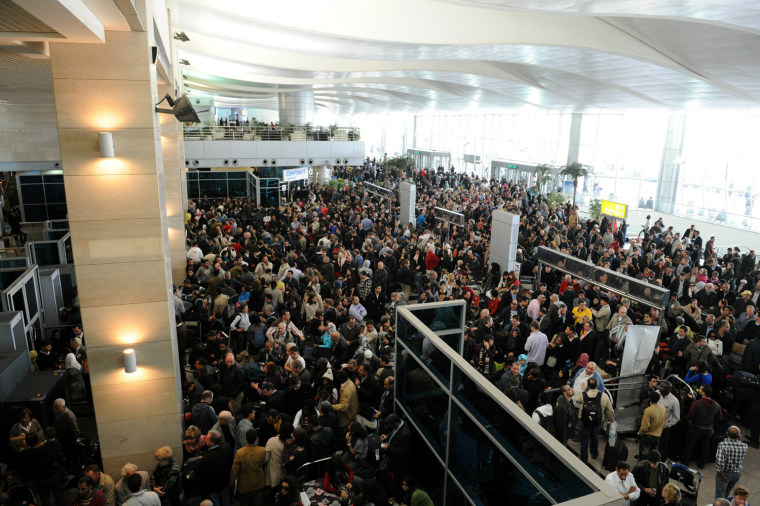 Image: People gather in Cairo s international a