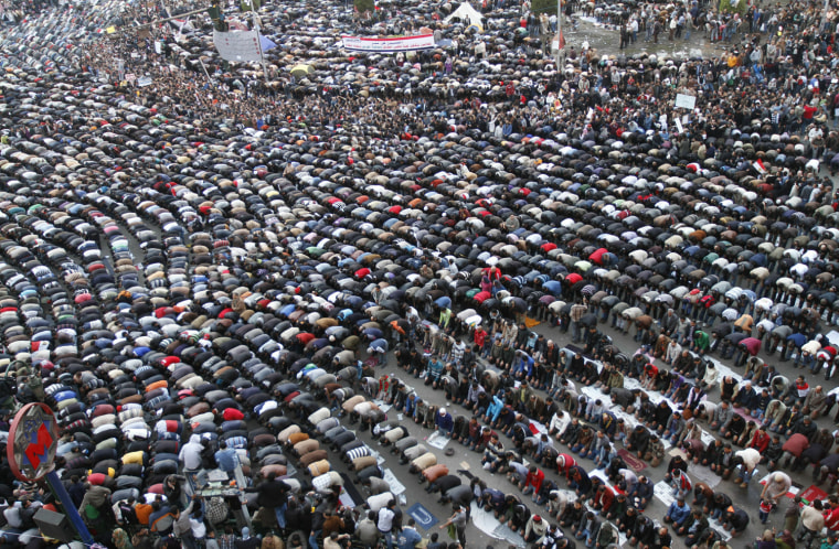 Image: Egyptian protestors pray on February 1,
