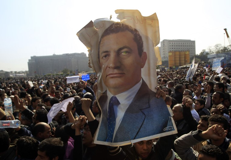 Image: Pro-Mubarak supporters march towards anti-government supporters in Tahrir Square in Cairo