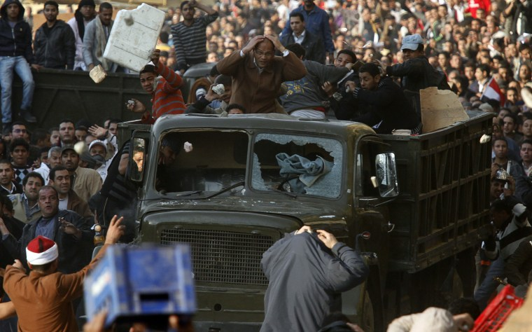 Image: Pro and anti-Mubarak supporters clash at Tahrir Square in Cairo