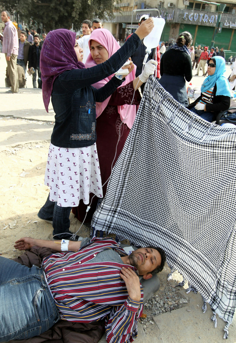 Image: An anti-government protester attached to an IV drip