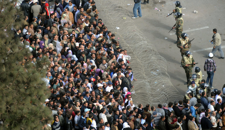 Image: Protesters gather in Cairo on Friday morning