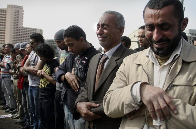 Image: Egyptian men pray in Tahrir Square, Cairo