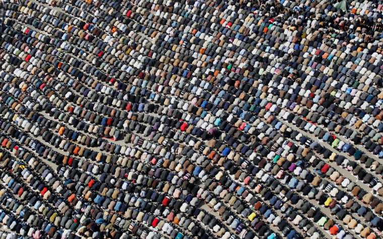 Image: Anti-government protesters take part in Friday prayers at Tahrir Square in Cairo