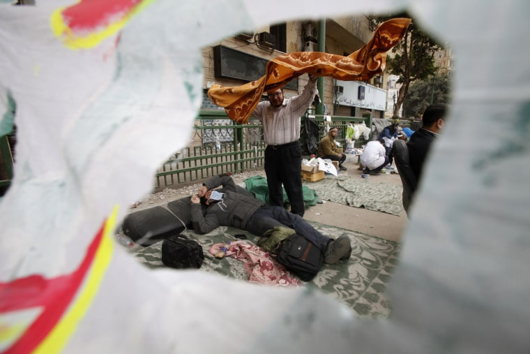Image: Opposition supporters sleep near Tahrir Square in Cairo