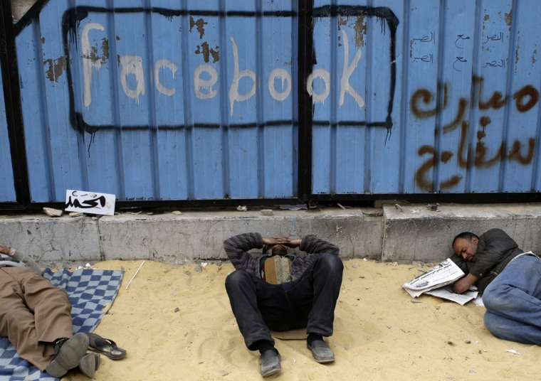 Image: Opposition supporters rest in Tahrir Square in Cairo