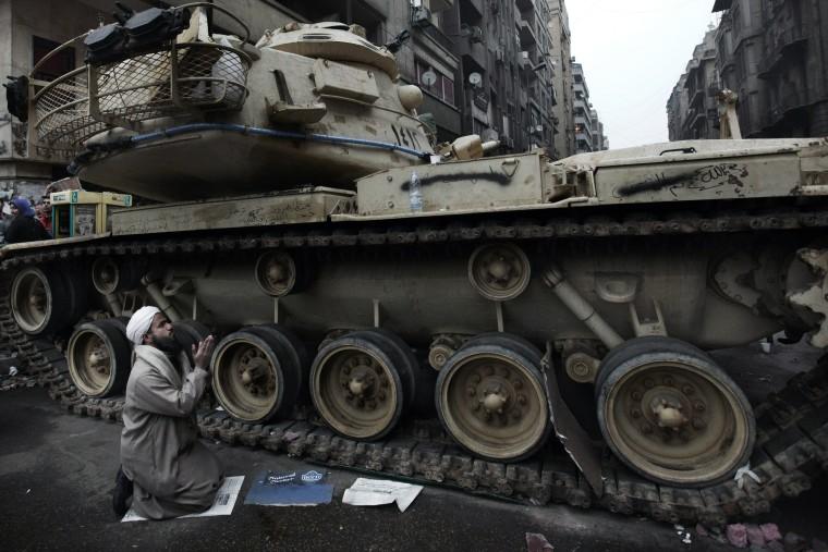 Image: An Egyptian anti-government protestor pr