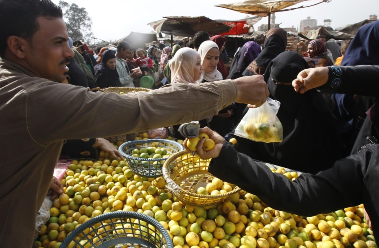 Image: Egyptians shop at a vegetable market in Cairo