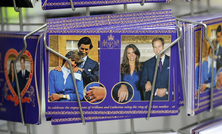 Image: Souvenir postcards on sale to mark the forthcoming wedding of Britain's Prince William and Catherine Middleton are seen at a shop in London
