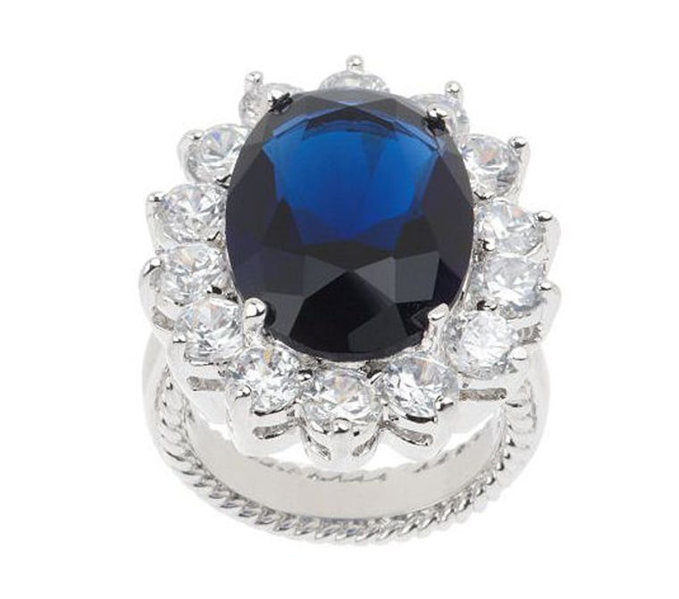 1/18 KJL Princess Simulated Sapphire Ring Blue blood brilliance. Sublime beauty reigns supreme in this stunning simulated sapphire ring. The oval, faceted simulated gemstone is surrounded by a sparkling border of clear, round simulated diamonds in prong settings. A polished fluted gallery frames this ring that shines with regal radiance. From Kenneth Jay Lane.