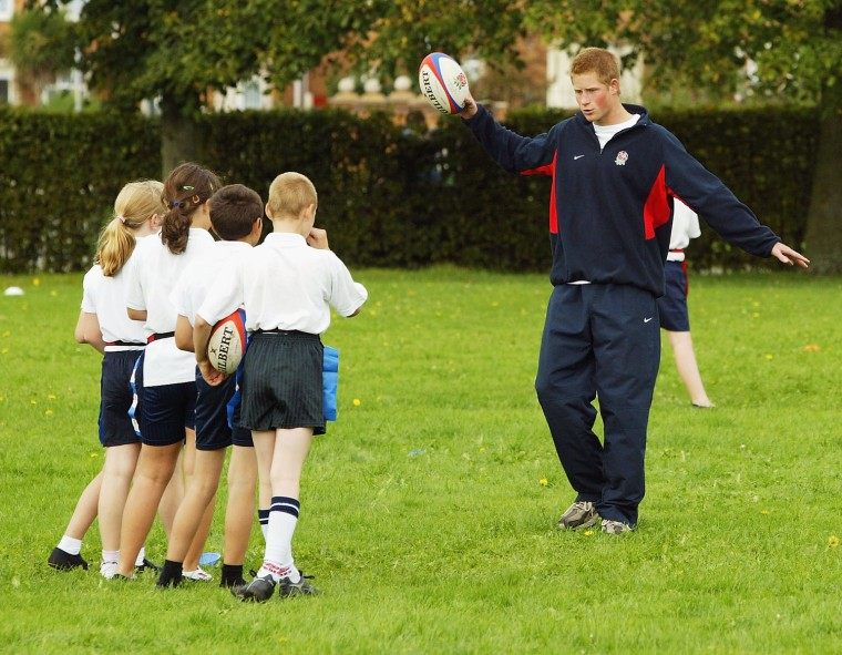 Prince Harry Helps Coach Rugby To School Children