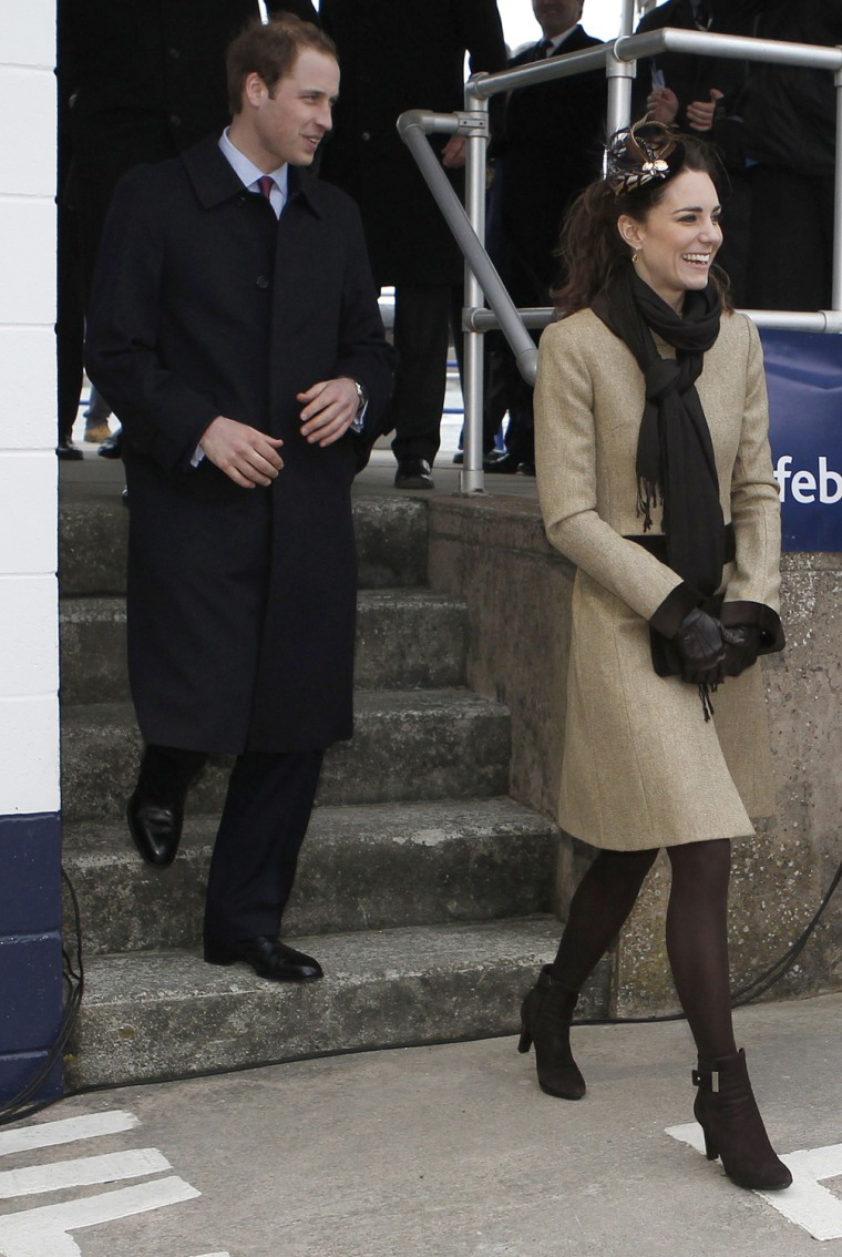 Image: Britain's Prince William and his fiancee Kate Middleton smile following a naming ceremony for new lifeboat 'Hereford Endeavour' at Treadur Bay lifeboat station on Anglesey