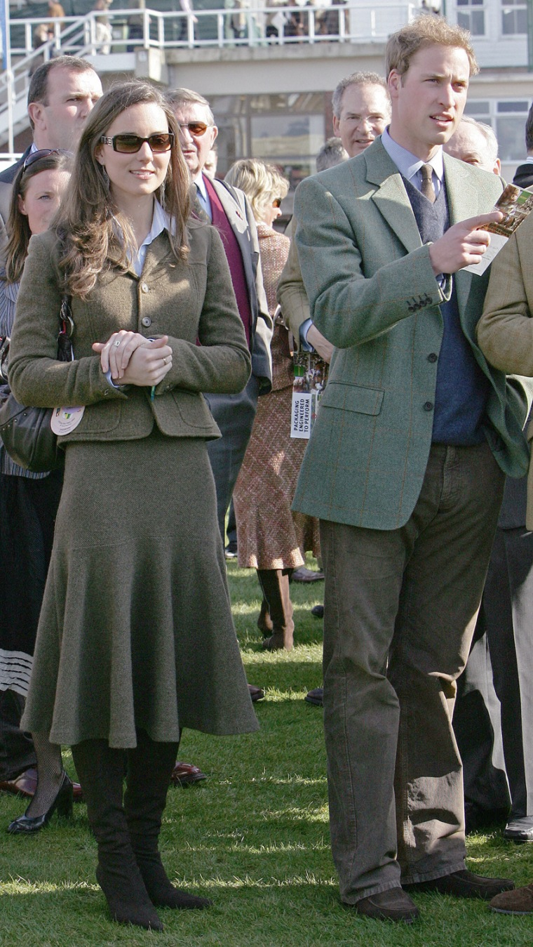 Prince William (R) stands beside girlfri