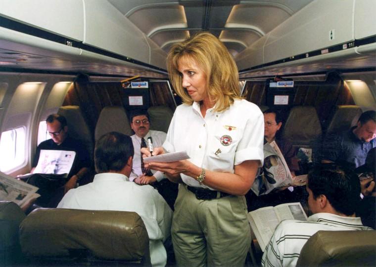 Southwest Airlines flight attendant taking beverage orders inflight.