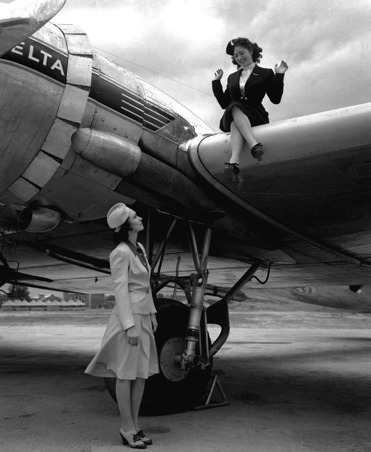 Delta Flight Attendants Jackson and Mills modeling (left) 1940-42 Summer uniform and (right) Winter 1940-1942 uniform.  Posed with DC-3, September 1941.