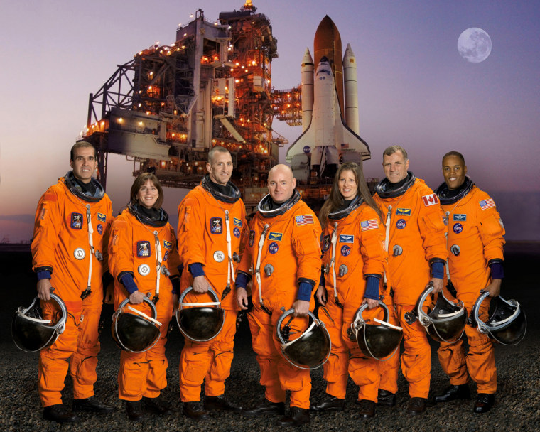 The STS-118 crew pose for their official portrait on Aug. 8, 2007. Rick Mastracchio, from left, Barbara R. Morgan, pilot Charles Hobaugh, mission commander Scott Kelly, Tracy Caldwell, Canadian Space Agency astronaut Dave Williams and Alvin Drew.
