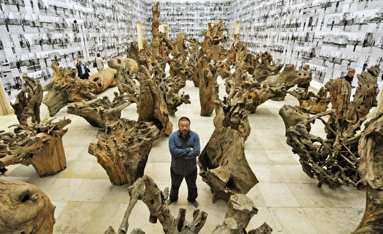Chinese artist Ai Weiwei poses in the mi