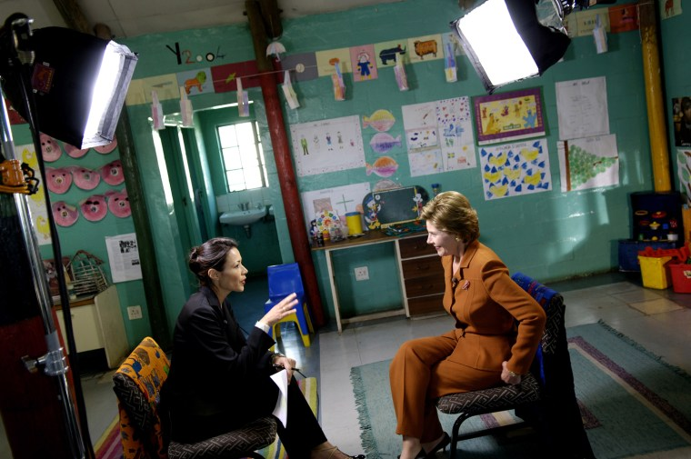 KHAYELITSHA, SOUTH AFRICA - JULY 12: US First Lady Laura Bush takes part in an interview with Anne Curry of NBC for the Today show in a classroom at the Philani training and learning center July 12, 2005 in Khayelitsha, near Cape Town, South Africa. (Photo by Charles Ommanney/Getty Images)