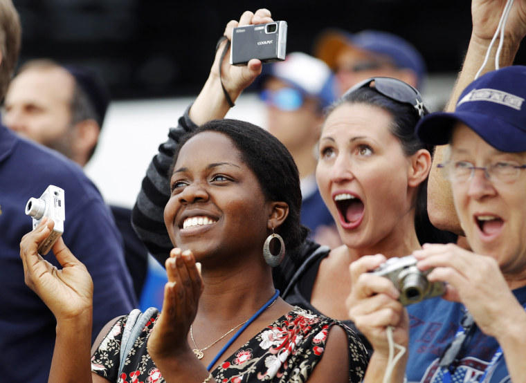 Image: Spectators react as the space shuttle Endeavour lifts off from the Kennedy Space Center in Cape Canaveral, Florida