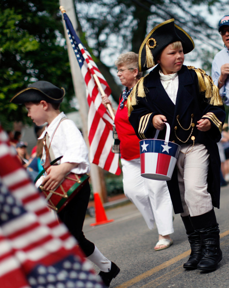 Image: Children and adults march in Fourth of July parade in Barnstable Massachusetts