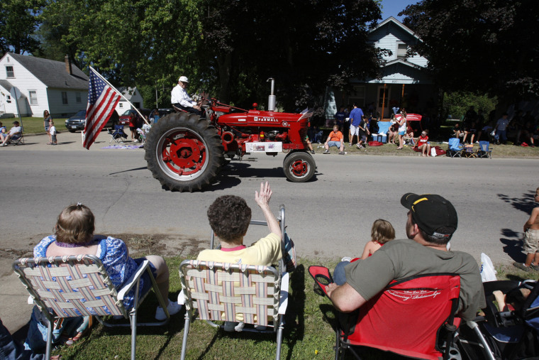 Image: Lyle Luloff, 93, sits atop his tractor during the Independence Day Parade in Independence