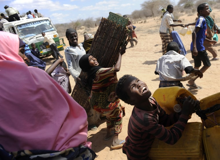 Image: Refugees load their belongings onto trucks as they choose to relocate to the newly-opened Kambioos settlement, at Kenya's Dadaab Refugee Camp