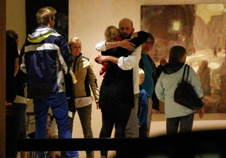 Image: People embrace inside a hotel where relatives of victims and survivors of a shooting which took place at a meeting of the youth wing of Norway's ruling Labour Partyon on Utoeya island gather in Sundvollen