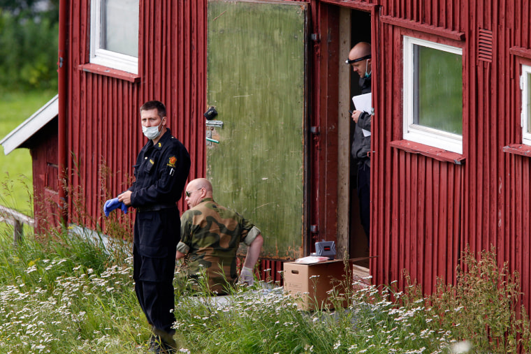 Image: Members of the police and army carry out searches on a farm rented by Anders Behring Breivik in the small rural region of Rena