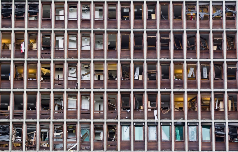 Image: Shattered windows of a government building are seen in Oslo