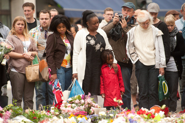 Image: People stand in front of the Domkirke church in central Oslo