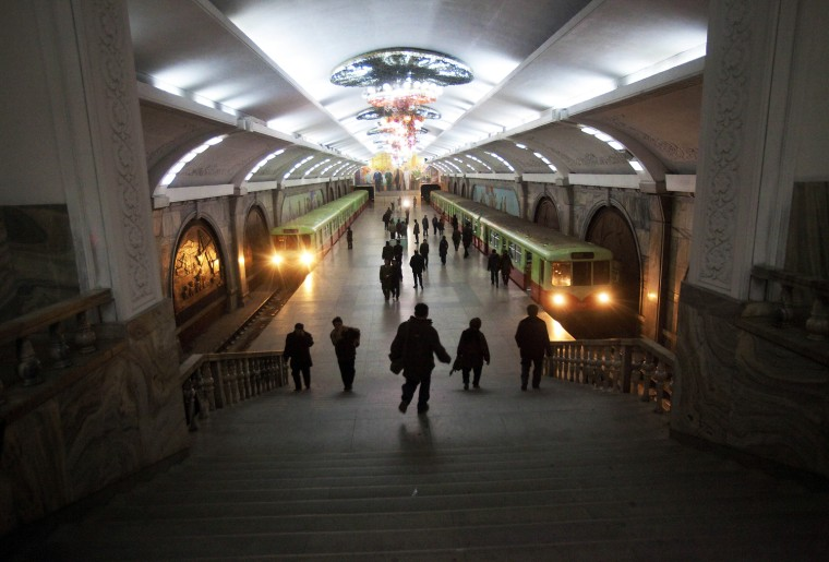 Commuters walk through a subway station in Pyongyang on March 10.