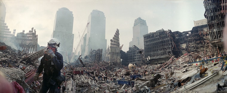 RESCUE WORKERS CONTINUE EFFORTS AROUND WORLD TRADE CENTER