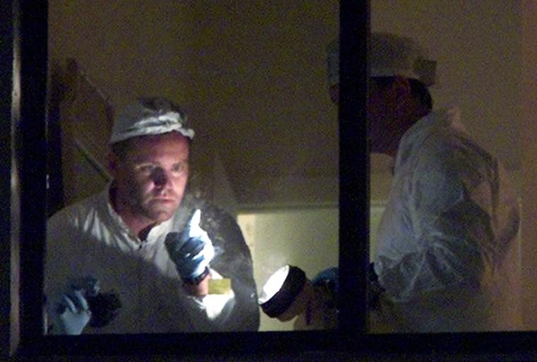 FBI CRIME LAB INVESTIGATOR POINTS TO FINGER PRINT ON WINDOW AT TERRORIST SUSPECTS CONDOMINIUM