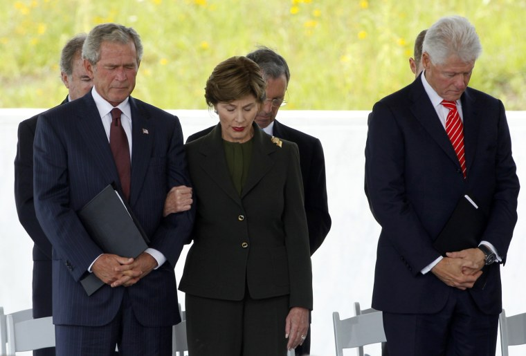 Image: Former U.S. presidents Bush and Clinton and former first lady Bush bow their heads during ceremonies in Shanksville