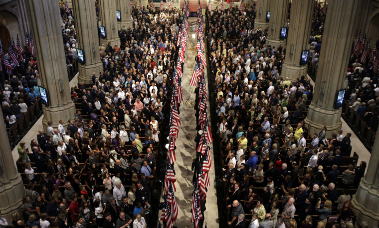 Image: Flags are carried into St. Patrick's Cathedral during ceremony to honor New York firefighters that were killed in 9/11 attacks on World Trade Center, in New York