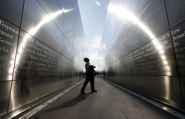 "Image: A man looks at the names on the wall of the newly opened ""Empty Sky"" memorial to victims of the 9/11 attacks on the World Trade Center in Jersey City"