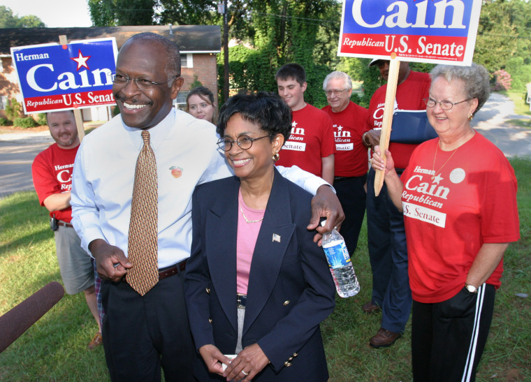 7-13-2004 Georgia Henry County McDonough Rob Felt / Daily Herald Republican senate candidate Hermain Cain held a press conference to promote advance voting after casting his ballot with his wife Gloria in McDonough, GA.