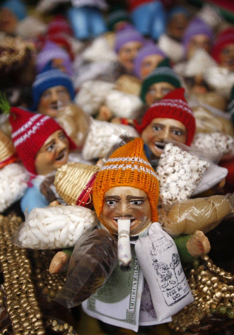 Image: Dolls of Anden Ekekos, known as the god of abundance, are displayed in a market in Lima
