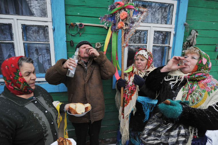 Image: Residents drink vodka during traditional