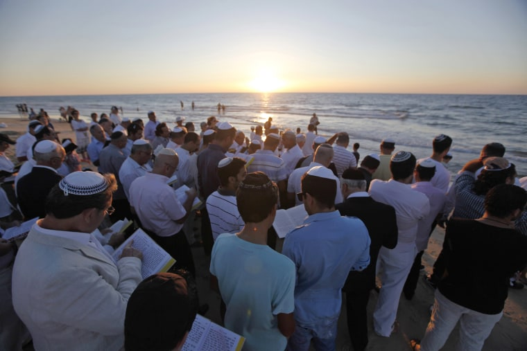 Image: Orthodox Jews takes part in the Tashlich prayer, a Rosh Hashanah ritual, on the shores of the Mediterranean Sea, in Ashdod