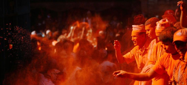 """Image: People throw vermillion powder on one another to celebrate the Nepali New Year, also known as """"Sindoor Jatra"""", at Bal Kumari in Thimi"""
