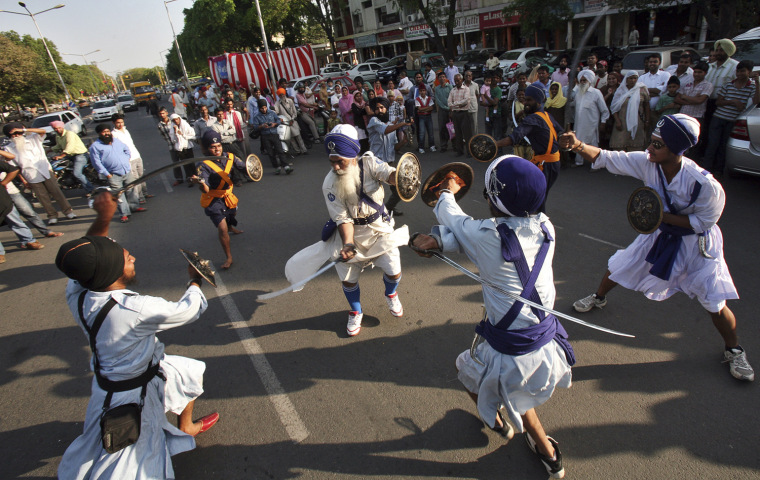 Image: Nihangs or Sikh warriors perform a sword-fight as part of Gatkha, a traditional form of martial arts, during a religious procession ahead of Baisakhi festival in Chandigarh