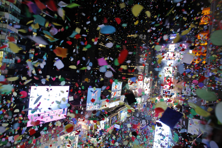Image: Confetti is dropped on revellers at midnight during New Year's Eve celebrations in Times Square in New York