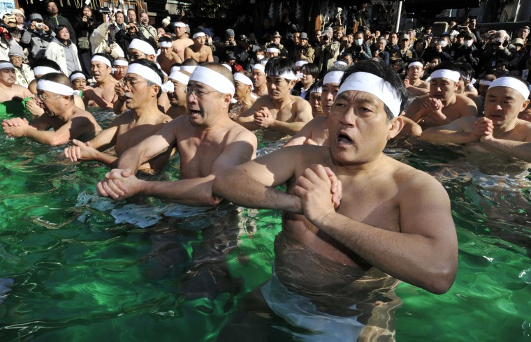 Image: Shinto believers pray in a ice-pool to p