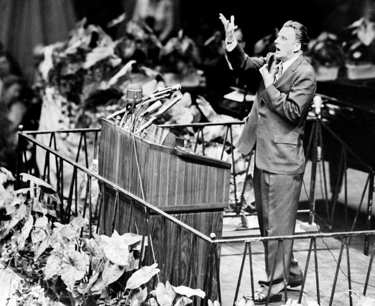 Image: Billy Graham, the American evangelist, preaches 20