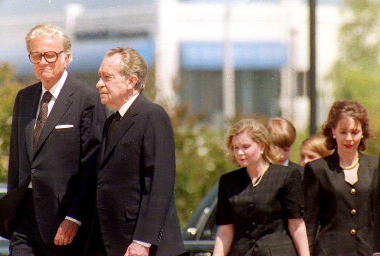 Image: Former President Richard Nixon (2nd-L) is accompan