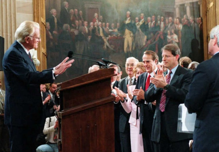 Image: Evangelist Billy Graham (L) is applauded on Capito