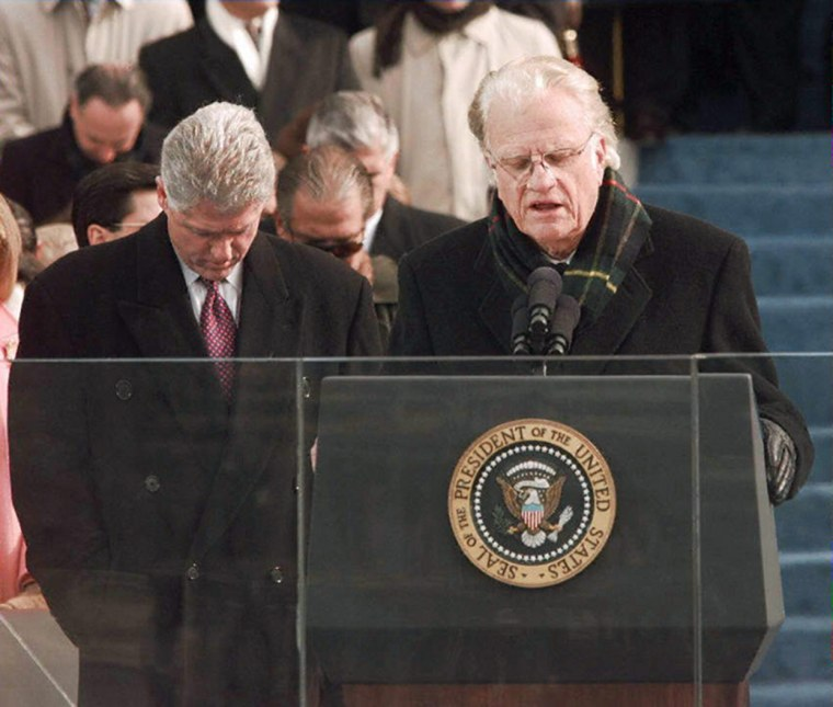 Image: US President Bill Clinton bows his head as Reveren