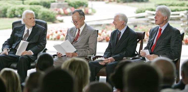 Image: George H.W. Bush, Bill Clinton, Jimmy Carter, Billy Graham